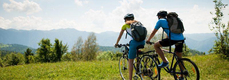 a couple riding mountain bikes