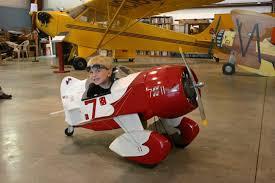 child in small plane