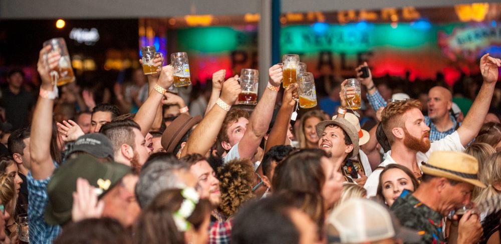 people cheering with beer mugs
