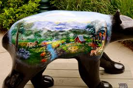 bear statue with painting on side